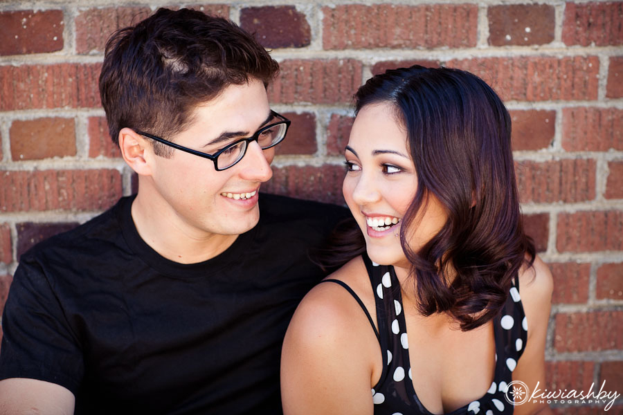 couple portrait photography in front of red brick